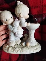 "1988 precious moments "" Your love is so uplifting"" - $25.00"