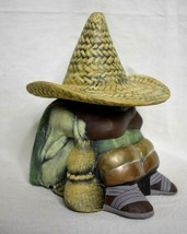 Sitting Man with Sombrero Figurine Metal legs Ceramic 6 inches tall - $10.88