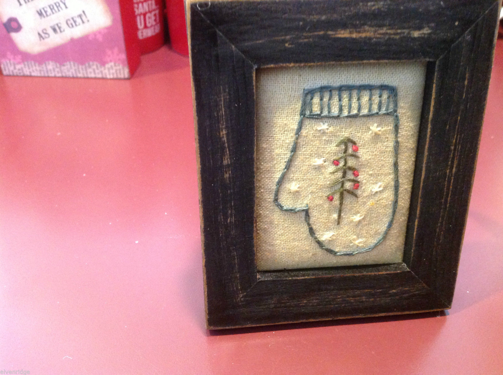 Vintage look framed fabric stitchery with Mitten greens red berries snowflakes