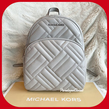 MICHAEL KORS ABBEY MEDIUM BACKPACK BAG IN QUILTED LEATHER PEARL GREY - $108.88