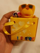 Flocked yellow dog in a bag Christmas xmas Ornaments decoration pre-owned - $14.92