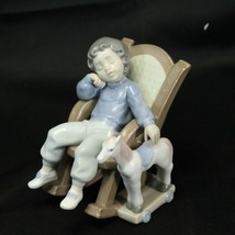 Lladro Spain Figurine #5846 All Tuckered Out boy in chair with toy horse... - $87.22