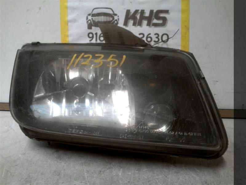 Primary image for Passenger Headlight Station Wgn Canada Fits 02-06 JETTA 318283