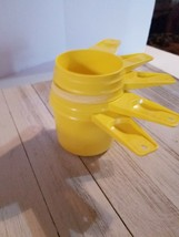 Vintage Tupperware 5 Piece Nesting Hanging Measuring Cups Yellow - $13.93