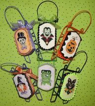 Monster Mash halloween sleds cross stitch chart Sue Hillis Designs  - $10.80