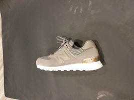 New Balance 574 Women Grey White Gold Bronze Lifestyle Sneakers WL574-FS... - $75.00
