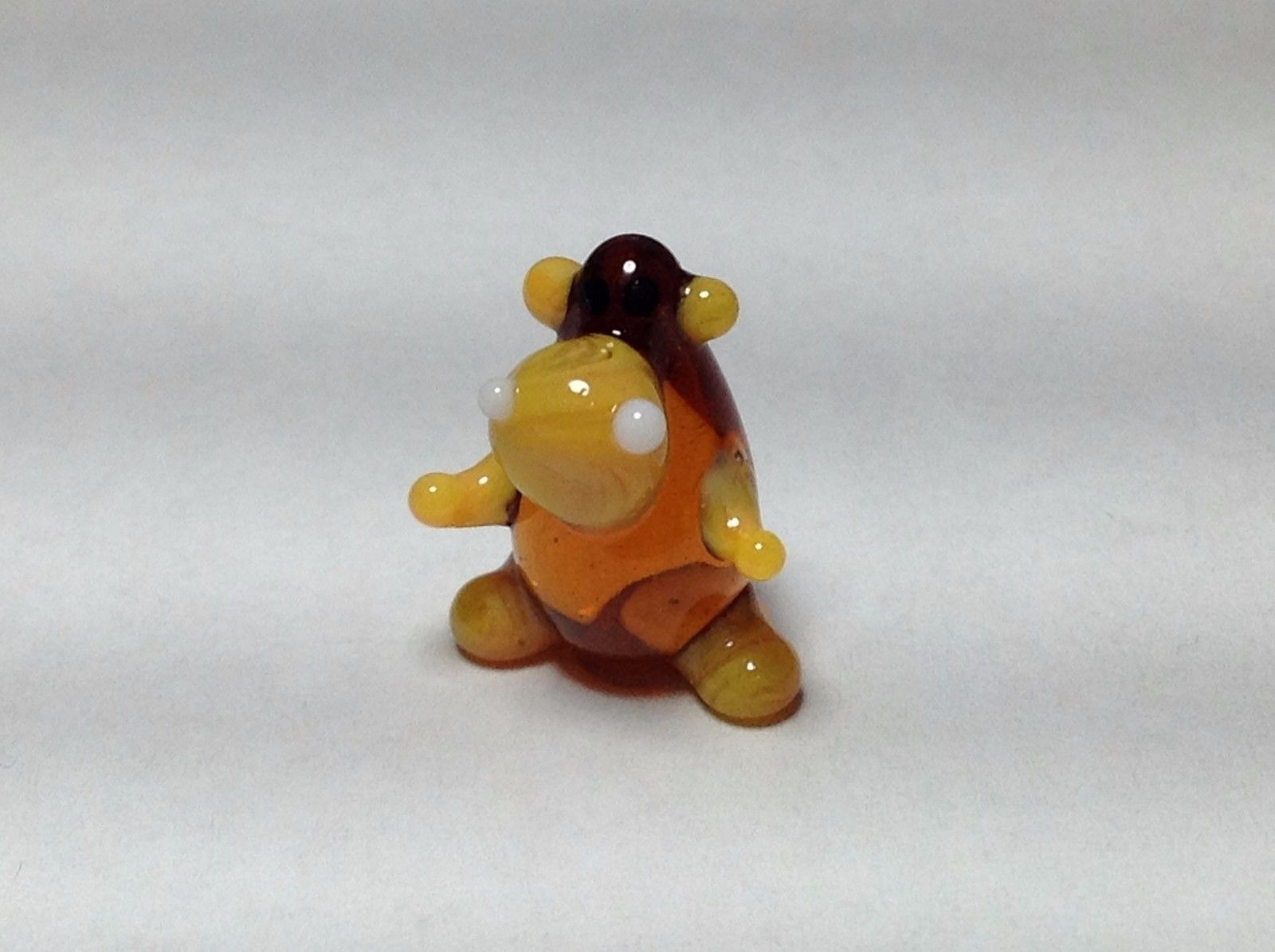 Miniature Glass amber sitting  hippo Handmade Blown Glass Made USA