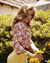 Jane Fonda Posing By Flowers 16X20 Canvas Giclee - $69.99