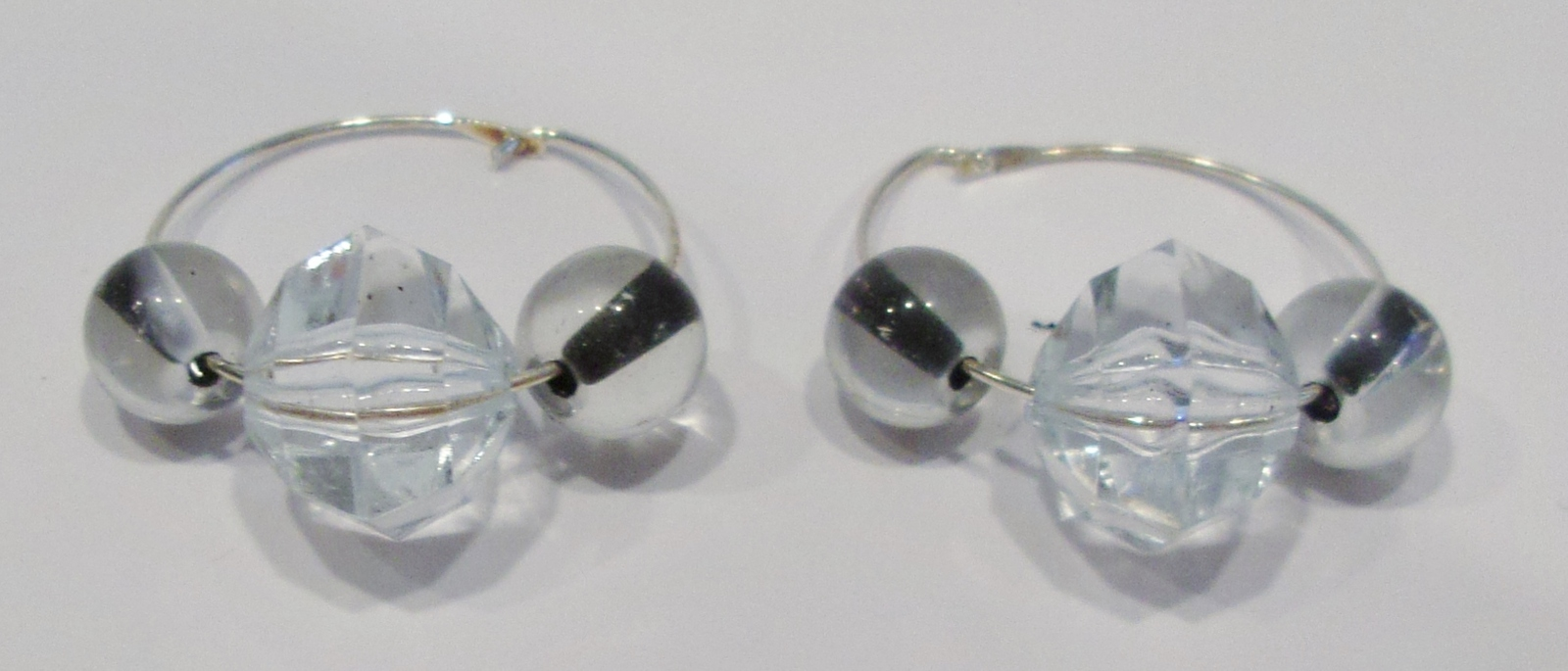 handmade silver hoop earrings with clear glass beads with black centers