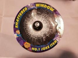 EIGHTBALL IN BROKEN GLASS WINDOW 7 inches diameter - $4.95