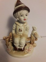 VINTAGE CERAMIC DUTCH BOY on Fence with Bird  FIGURINE - $7.72
