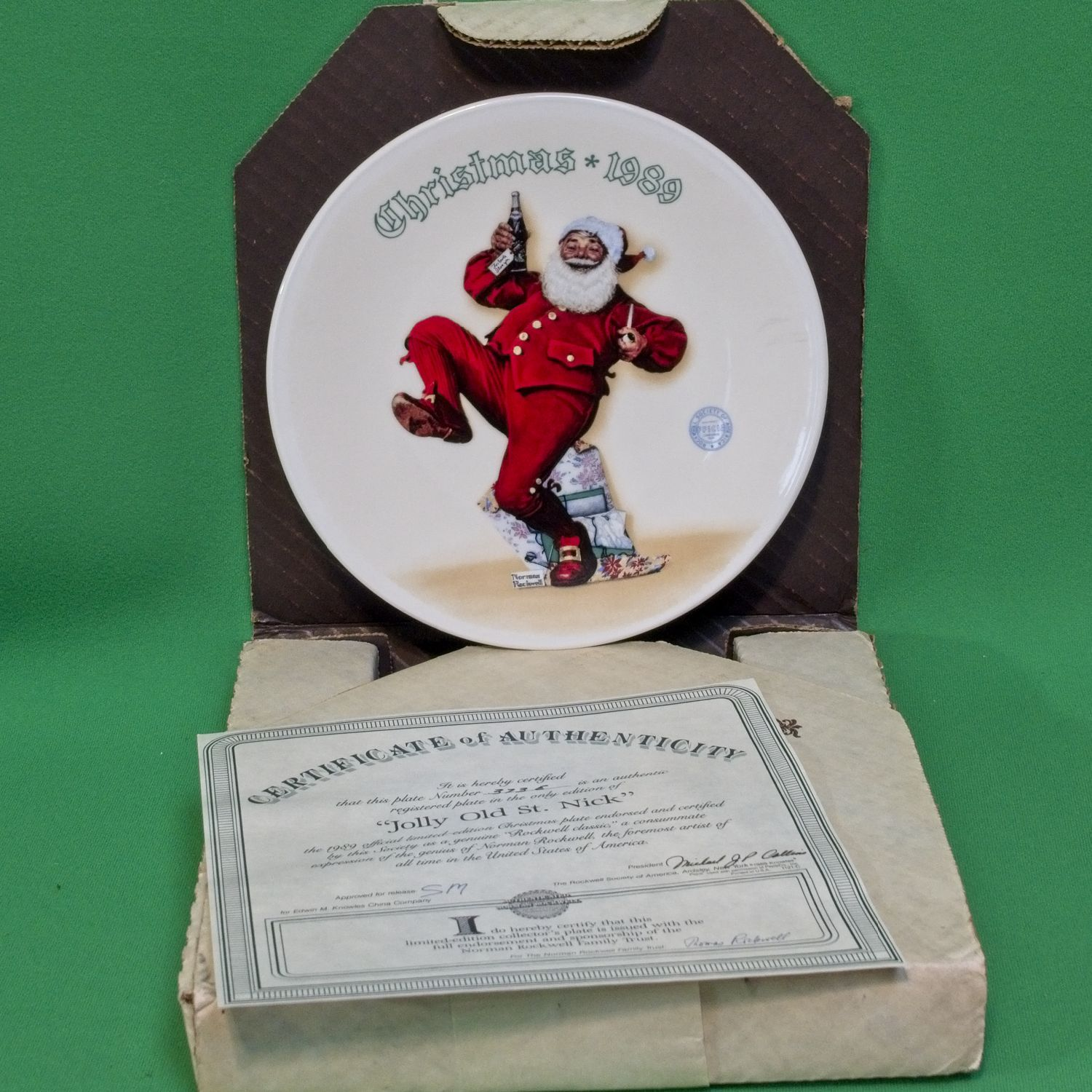 "1989 Knowles Norman Rockwell Christmas Collector Plate, ""Jolly Old St. Nick."""
