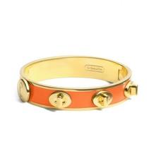 NWT COACH Half Inch Turnlock Bangle Bracelet Cuff Jewelry Gold Orange F9... - $61.71