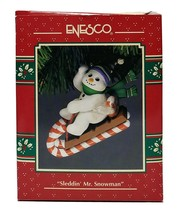 1993 Enesco Sleddin' Mr. Snowman Christmas Ornament - $20.00