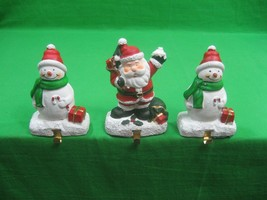 Set of Three (3) Stocking Hangers Snowman and Santa Resin - $15.85