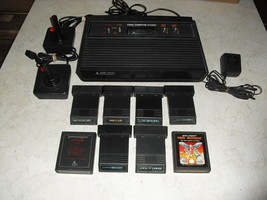 Atari 2600 4 Switch With Joysticks, Adapter, 8 Games Astroblast, Combat, Soccer - $148.49