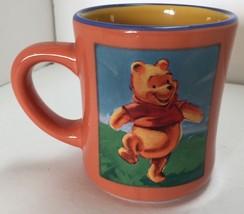 The Disney Store Orange Winnie The Pooh Coffee Mug - $14.80