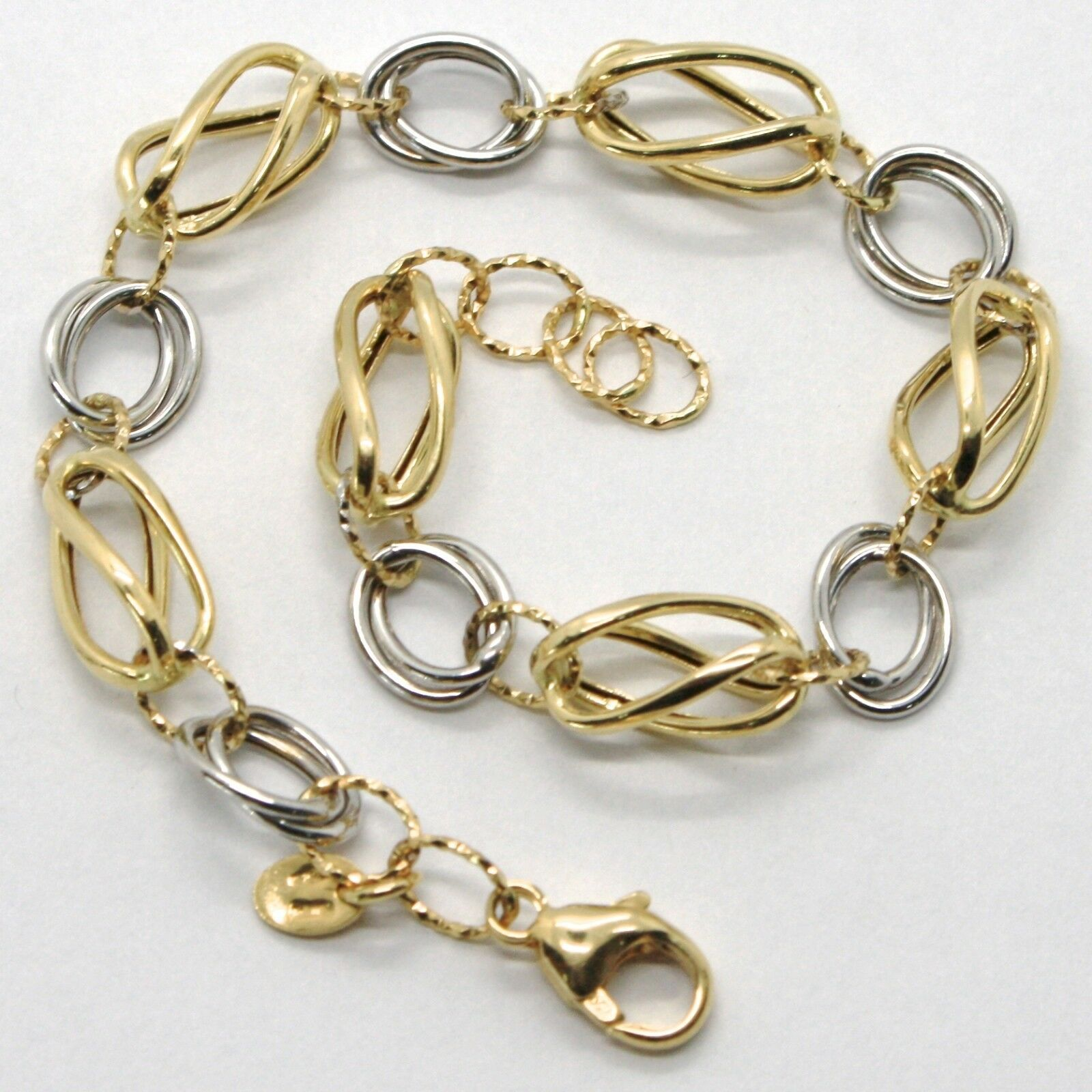 18K WHITE & YELLOW GOLD BRACELET ALTERNATE FINELY WORKED TWISTED OVAL LINK