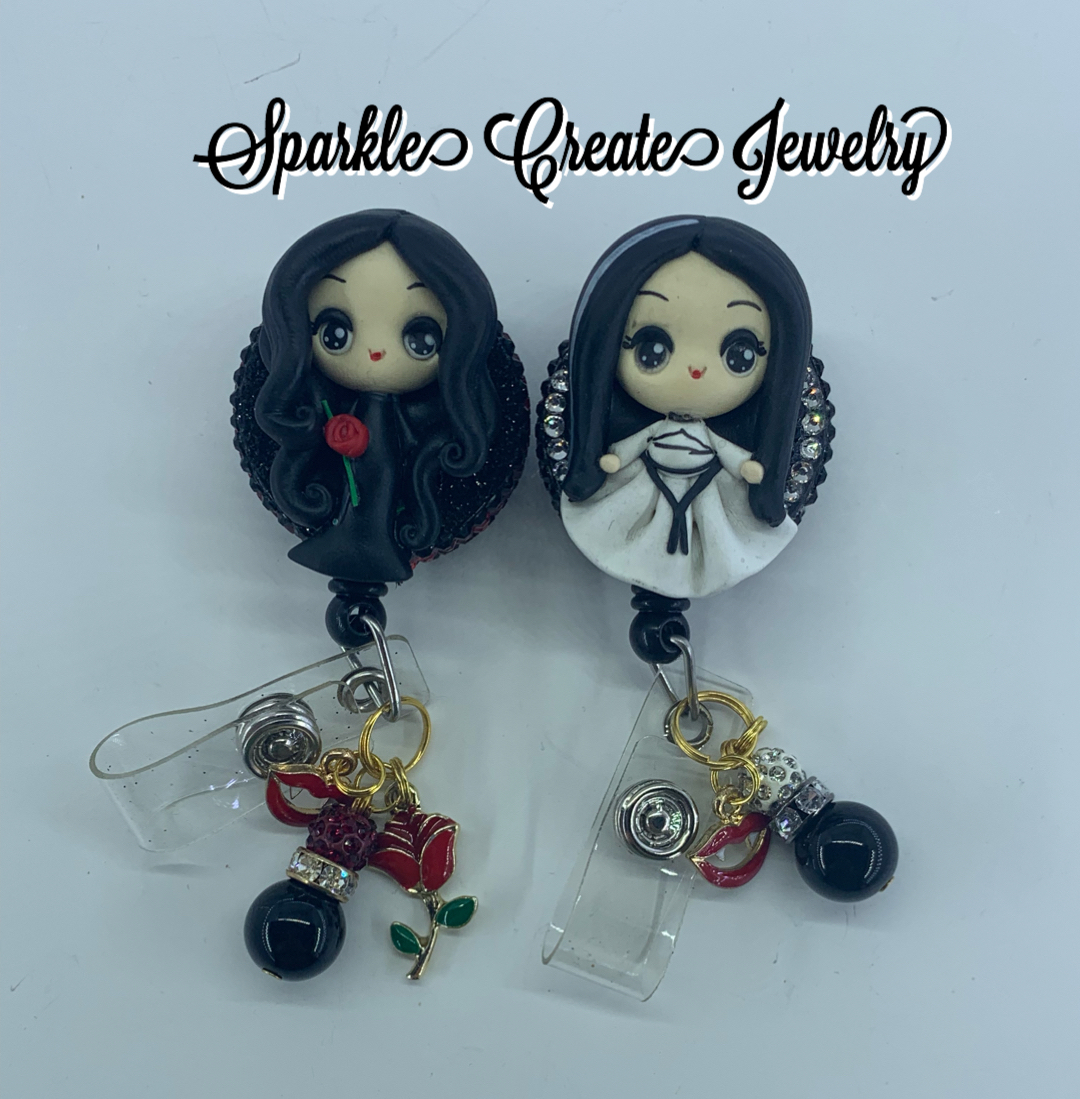 Lily Munster and Morticia Addams Clay Badge Reel