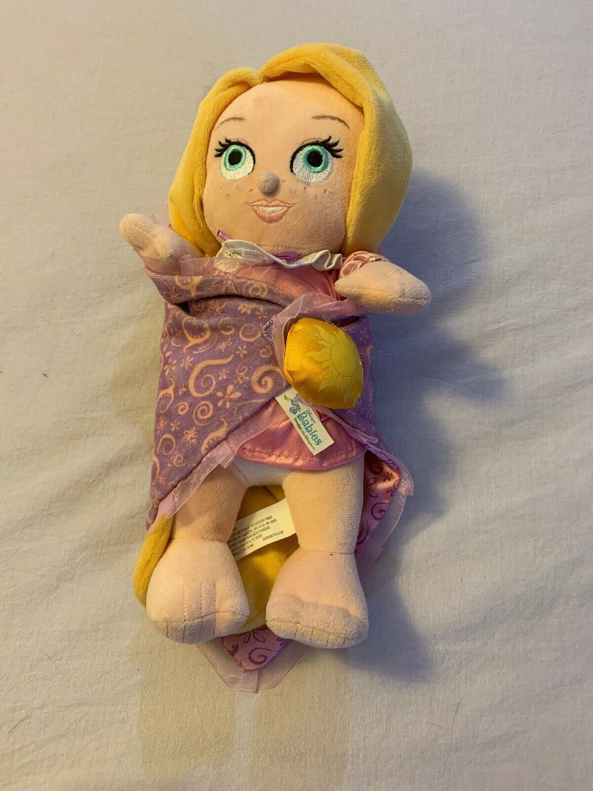 "Primary image for Disney Parks Disney Babies Tangled Rapunzel Plush Baby Doll in Blanket 12"" EUC"