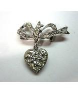Vintage Silvertone Metal Rhinestone Bow Brooch with Dangling Heart Photo... - $9.99