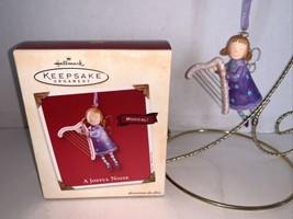 Hallmark Keepsake Ornament A Joyful Noise 2002 - $5.00