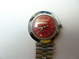 RARE RED DIAL 1974 CARAVELLE WINDUP WATCH RUNS WHEN WOBBLED TO REPAIR ST... - $125.00