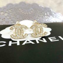Chanel clip on Earrings CC Logo Gold rhinestone 01A 733 - $448.36