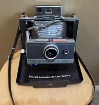 Vintage POLAROID First FOLDING Automatic 100 Land CAMERA in Built In CAS... - $60.00