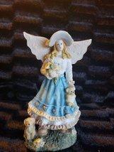 Angel Figurine  #74 - $3.00