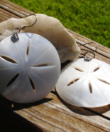 Vintage Carved Mother of Pearl Sand Dollar dangle Earrings - $75.00