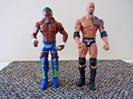 Lot Of 2 WWE Wrestler Action Figures,2011 The Rock,2012 Kofi Kingston  - $26.17
