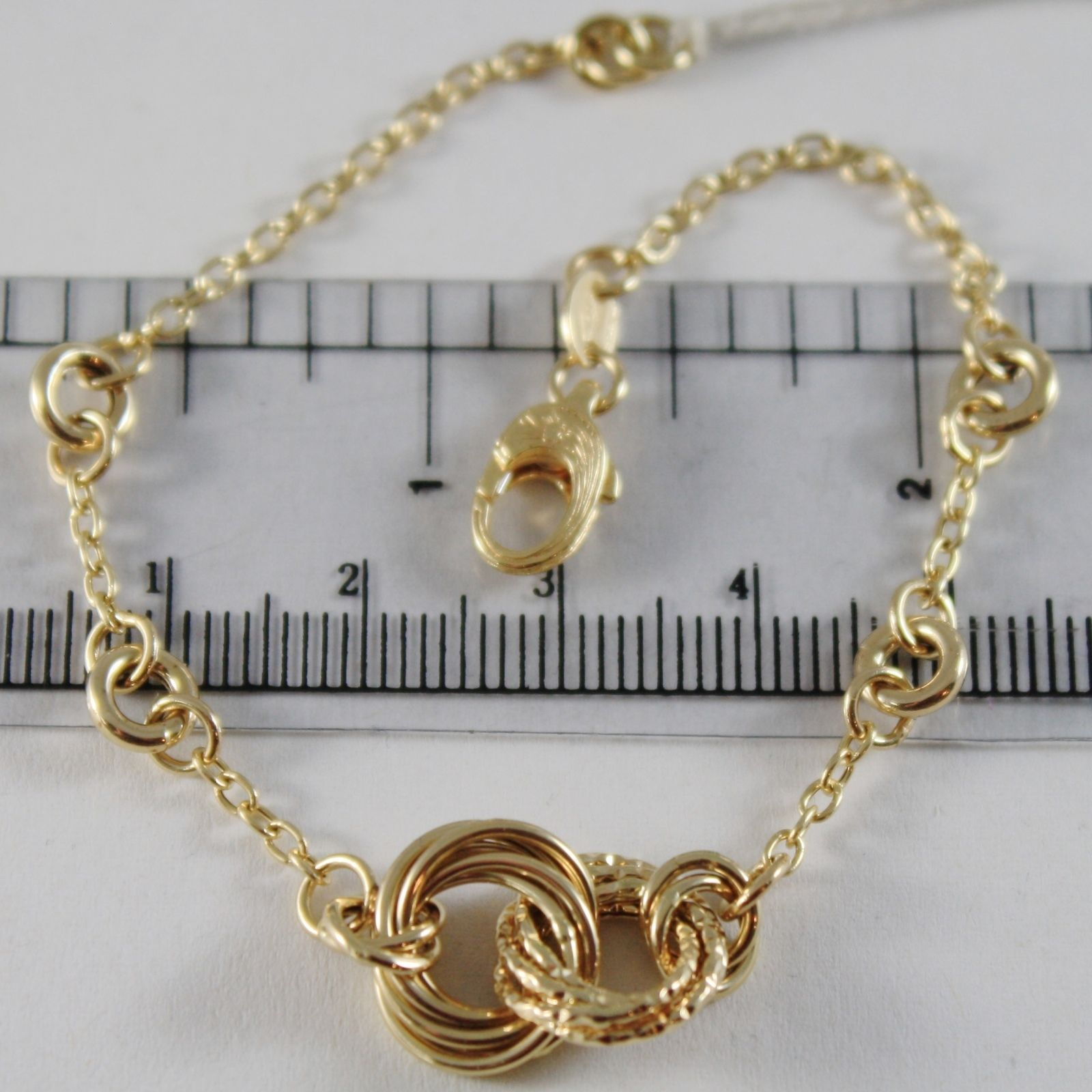 18K YELLOW GOLD BRACELET WORKED CROSSED CIRCLES 12 MM, 7.50 INCHES MADE IN ITALY