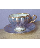 Vintage Japan blue and gold roses iridescent china tea cup teacup and sa... - $48.51