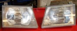 03 04 05 06 Ford E150 E250 E350 E450 OEM headlight headlamps lens both sides - $44.55