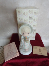 This is a Precious Moments #110116 December Figurine (#2627) - $17.99