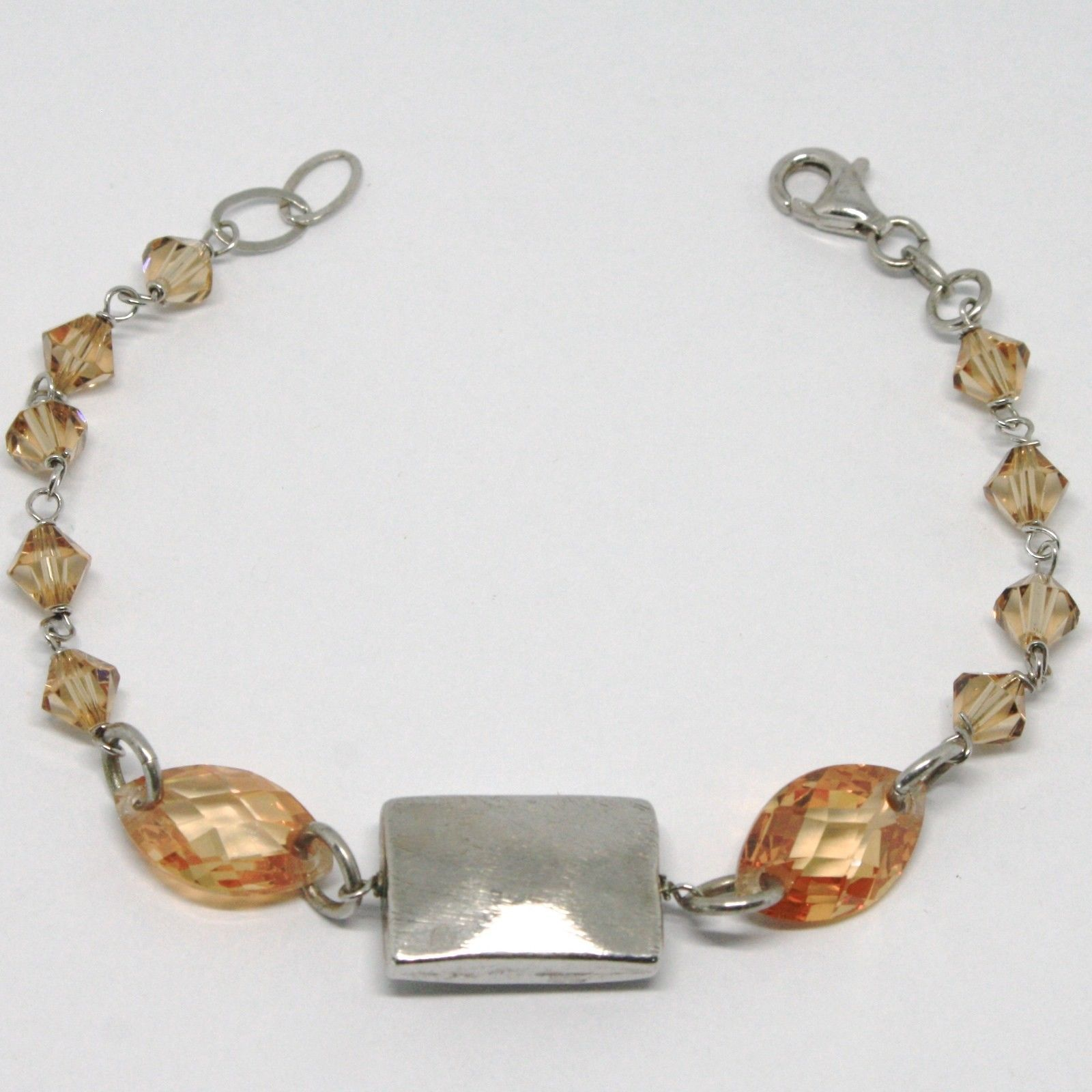925 STERLING SILVER BRACELET ORANGE FACETED OVAL, WORKED CENTRAL PLATE RECTANGLE
