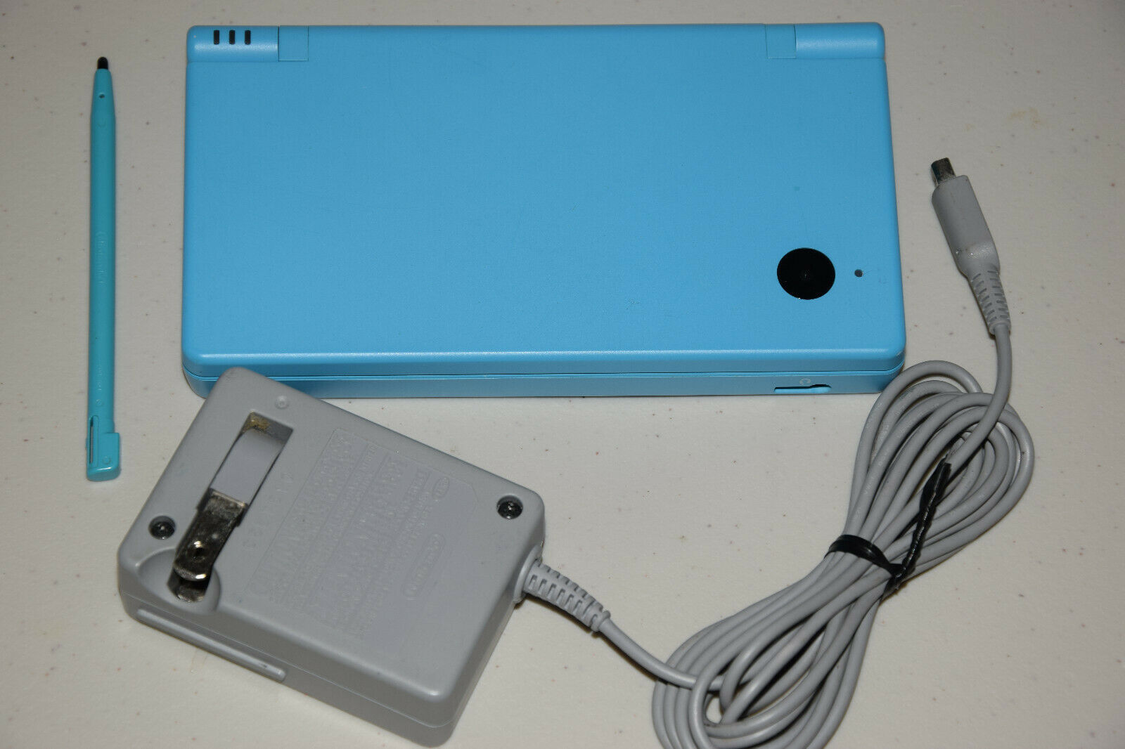 Primary image for Nintendo DSi Launch Edition Light Blue Handheld System Game Console TWLSUBA Mint