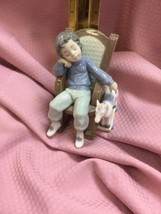 Lladro # 5846 All Tuckered Out - Child in a Rocking Chair - $52.25