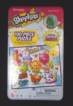 Shopkins 100 pce puzzle in collector tin with green shoe figurine New Sealed - $7.95