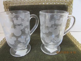 DISNEY PAIR OF CLEAR TALL GLASS COFFEE MUGS FROSTED MICKEY EARS MOTIF TA... - $6.88