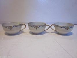 3 VINTAGE JAPANESE PORCELAIN FLORAL DESIGN TEA CUPS - $9.99