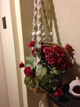 silk plant in basket with macrame hanger - $49.99