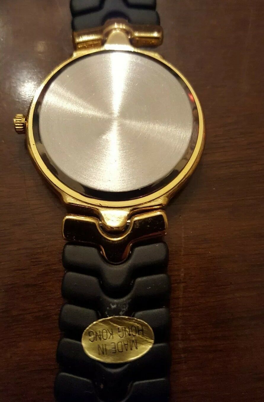 VINTAGE THE ORYX QUARTZ GOLD & BLACK FLEX BAND WRIST WATCH JAPANESE MOVEMENT image 6