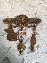 Vintage 1960's New Baby Angel Blessing Dangling Brooch With Toys - $14.00