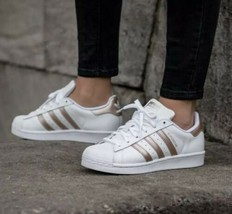 Preowned ADIDAS SUPERSTAR J WHITE ROSE GOLD RUNNING SHOES Size 7.5 WOMENS - $50.00