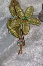 Green unusaual flower pin brooch vintage aurora borealis string weaved - $17.00