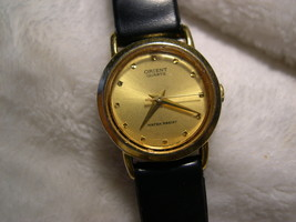 "L18, ORIENT Ladies Watch, Gold Face, 7.5"" Black Band, KY 05SP4  - $49.69"