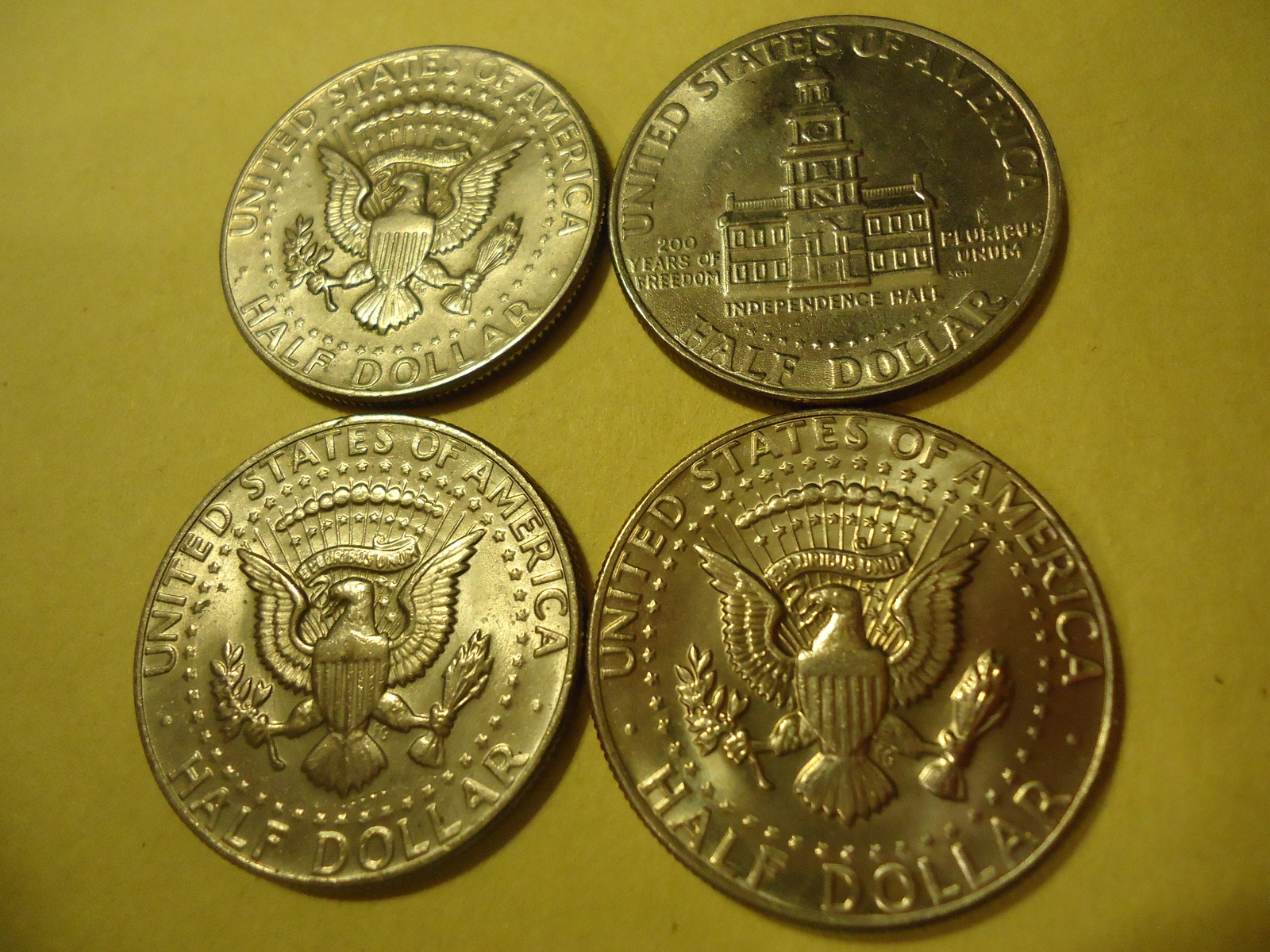 Primary image for LOT OF 4 KENNEDY HALF DOLLARS (DIFFERENT DATES ONE IS 1983)  COMBINED SHIPPING 4