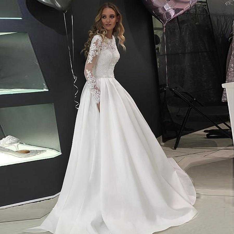 Ulle high neckline a line wedding dresses long sleeves crystals bridal dress button down wedding